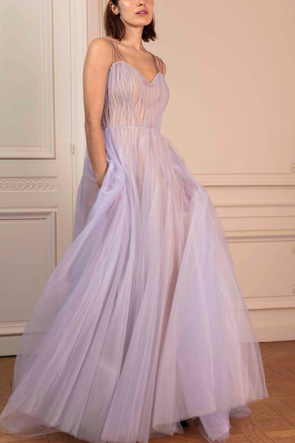 Lavender gown in layered tulle with sweetheart neckline, ribbon straps and train