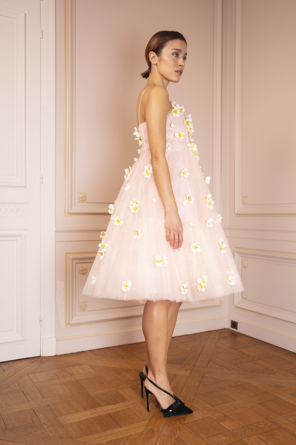 Pale pink frou-frou dress embellished with blossoms