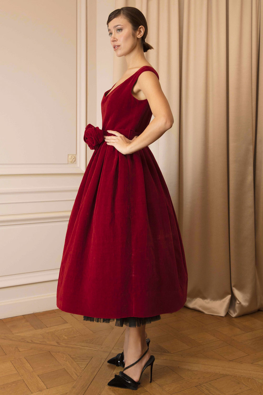 Fit-and-flare frock in Bordeaux velvet with corsage of roses