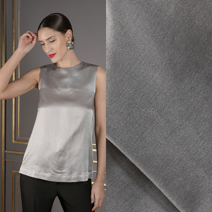 Grey tank with multipaneled back